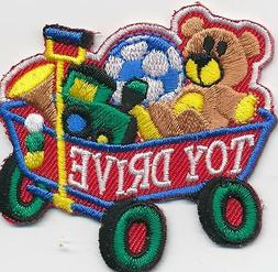 Boy Girl Cub TOY DRIVE Wagon Donation Fun Patches Crests Bad